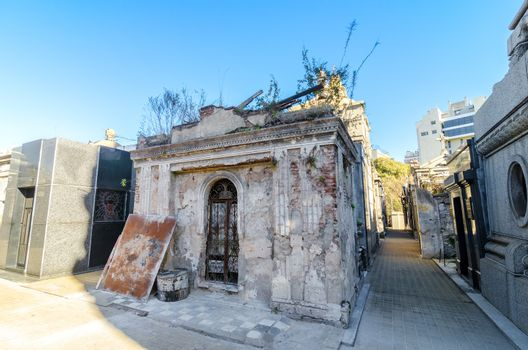 Old and damaged tomb in the historic Recoleta cemetery in Buenos Aires, Argentina