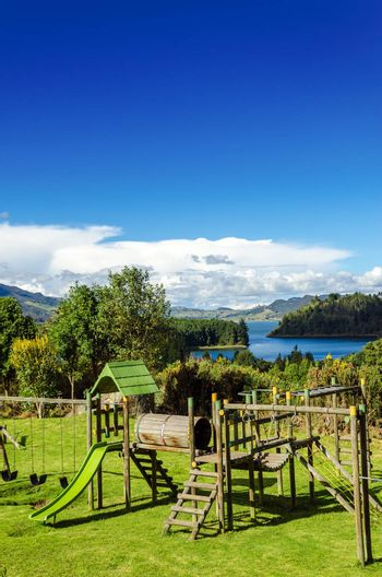 Vertical view of a playground in a natural setting with Neusa lake in the background in Cundinamarca, Colombia