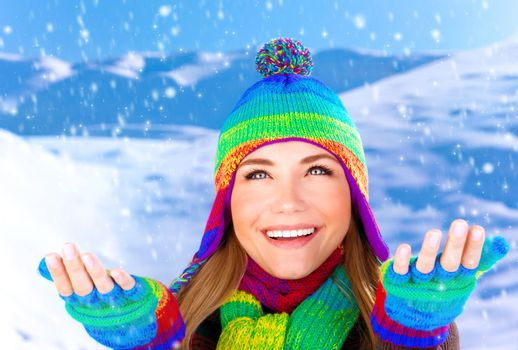 Cheerful female catching snowflakes