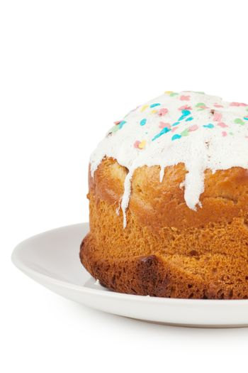 Closeup view of cake with icing on a plate over white background