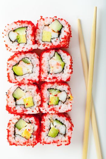 Close up top view of sushi and chopsticks