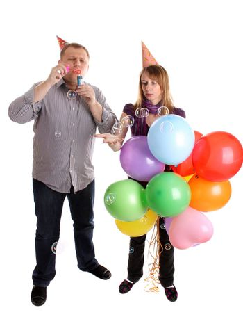 Happy Couple with baloons and bubbles isolated on the white