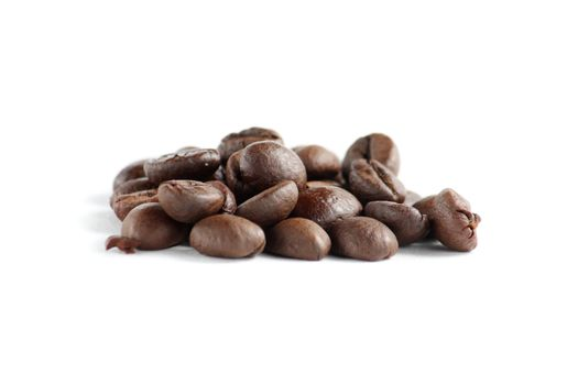 A lot of roasted coffee beans at dark background