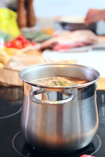 Stell saucepan with soup at the kitchen