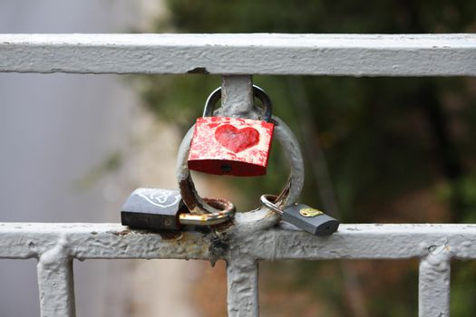 Some locks with heart on a fence