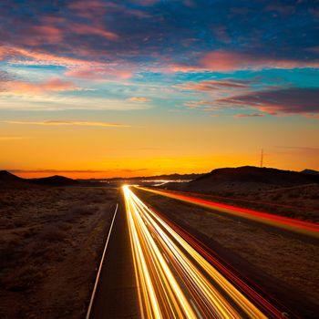 Arizona sunset at Freeway 40 with cars light traces