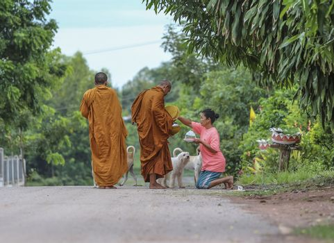 Loei province , Thailand - JULY 18: Every day very early in the morning, Thai people donated food to the monks on july 18, 2013 in Loei province , Thailand
