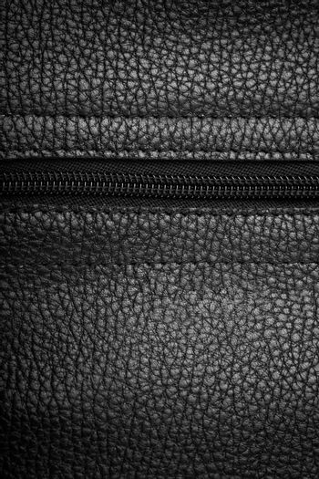 Macro view of black leather background with zipper