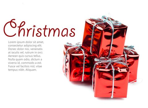 Closeup view of vibrant red christmas decorations in shape of gift boxes
