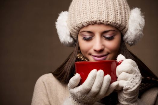 Portrait of beautiful winter woman with a cup of coffee or tea