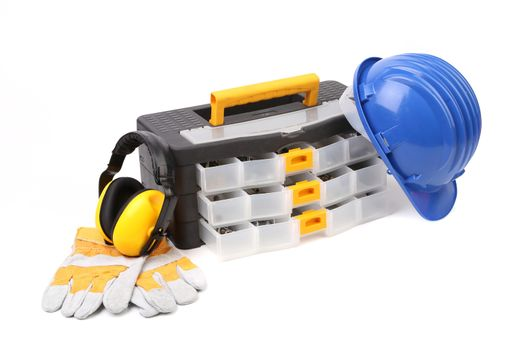 Toolbox with earmuffs gloves and hardhat.