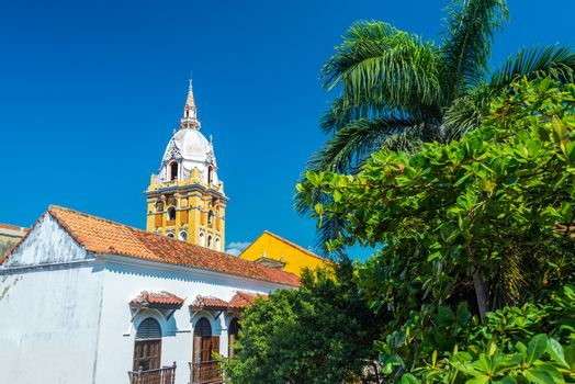 View of the cathedral of Cartagena, Colombia next to lush green trees