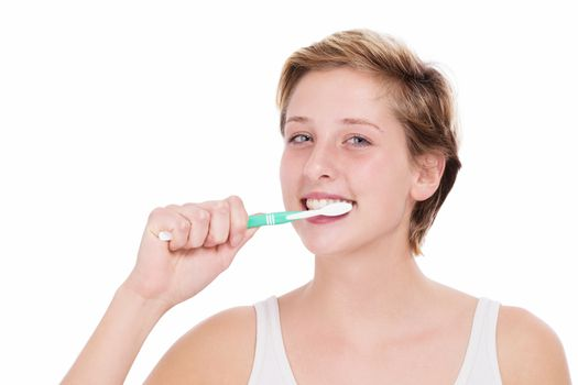 young blonde woman brushing her teeth on white background