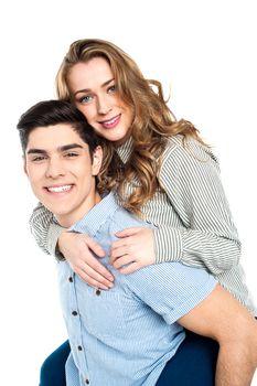Girlfriend enjoying piggyback ride