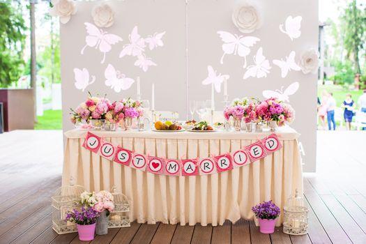 Wedding white banquet tables prepared for celebration