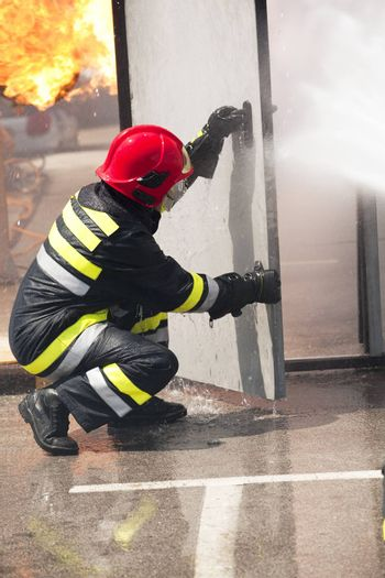 Firefighter fighting fire during training