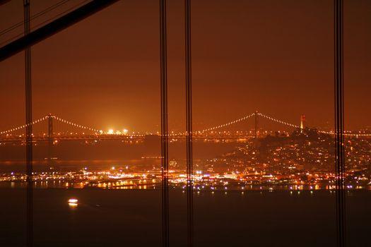 Bay Bridge seen from the Golden Gate Bridge at night