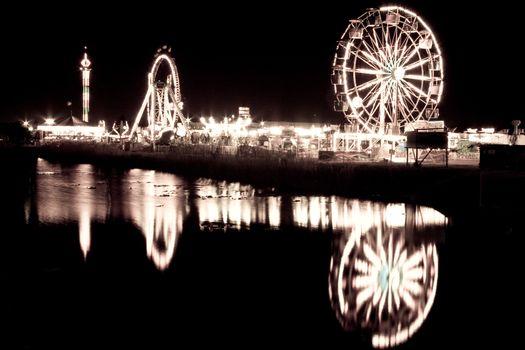 Ferris wheels by lake