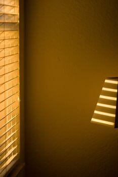 Sunlight shining through blinds