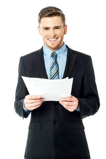 Businessman holding important deal documents