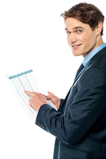 Businessman cross-checking annual report