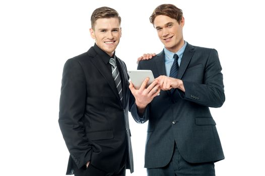 Businessmen browsing on tablet device