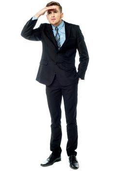 Businessman looking far far away
