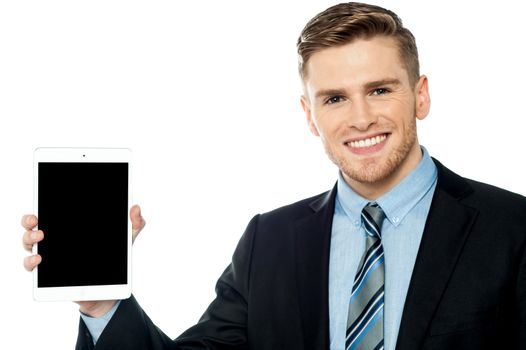 Salesman displaying new tablet device