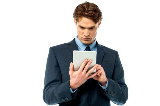 Serious corporate working on tablet pc