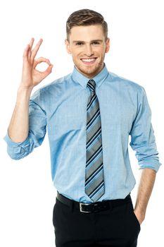 Executive gesturing perfect sign