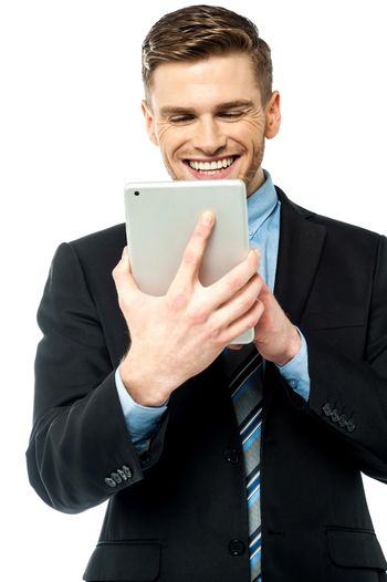 Businessman operating tablet device