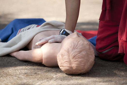 Chest compressions on a dummy