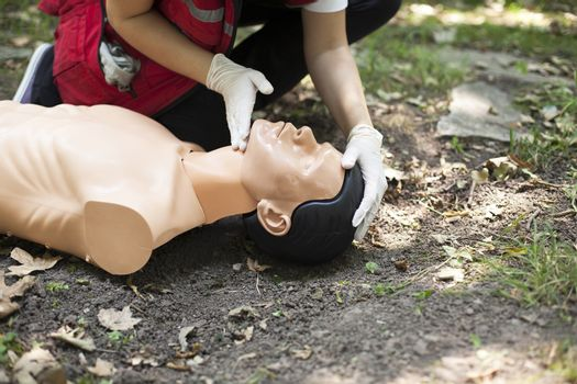 Demonstrating CPR on a dummy