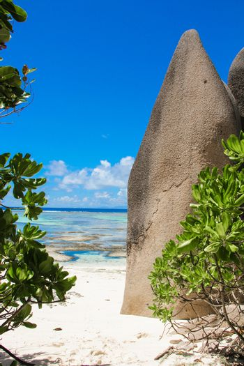 Exotic lagoon between large smooth rocks in the Seychelles