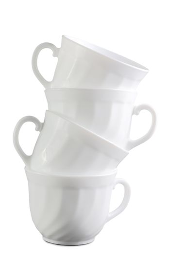 Pile of white cups isolated at the white background
