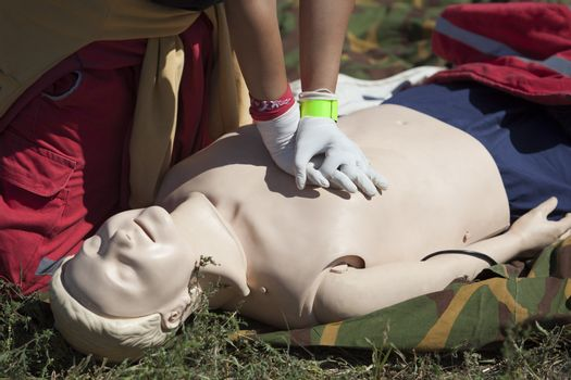 Paramedic demonstrates CPR on dummy