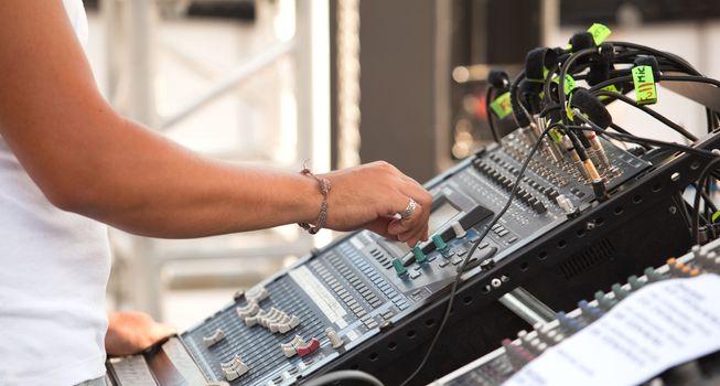 Sound control engineer in outdoor concert event