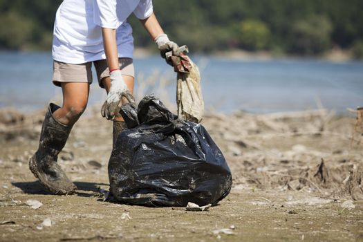 Women volunteer cleaning the environment