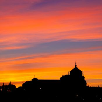 Silhouette of catholic church in sunset.
