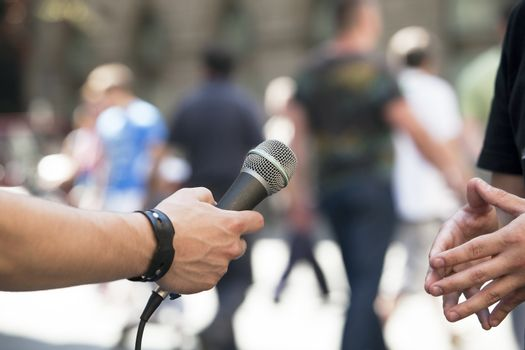 Interview with media microphone held in front of businessman, spokesman or politician