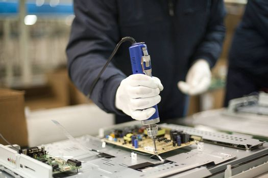 Electronic technician at work