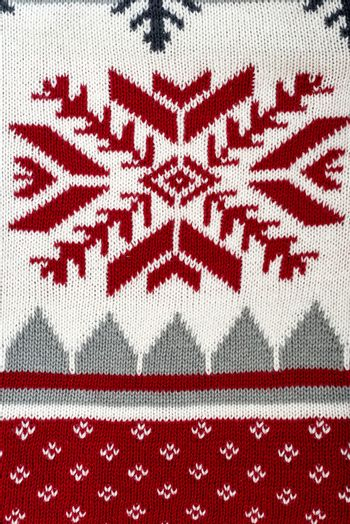 Knitted background with Christmas ornament
