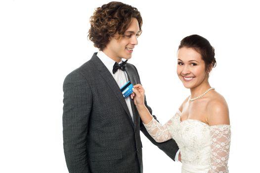 Pretty bride holding debit card