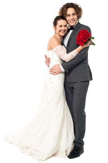 Lovely young married couple embracing warmly