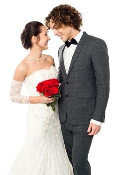 Girl flirting with her guy, wedding concept.