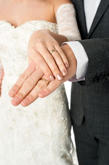Couple showing their wedding bands