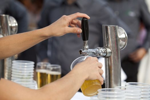 A beer being poured from a beer tap