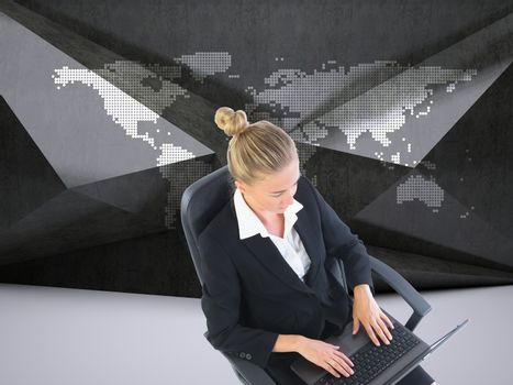 Businesswoman sitting on swivel chair with laptop