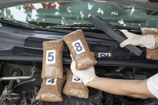 Hidden drugs in a vehicle compartment