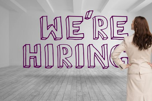 Businesswoman looking at were hiring graphic